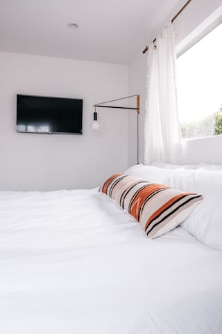 Our guests rave about our beds. Get a good night's rest with our luxury comfort queen mattress, and Brooklinen premium linens and pillows.  Decked out with a TV and Bose speakers.