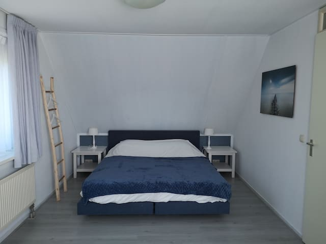 Master bedroom with kingsize box spring