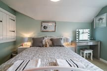 Large double room with comfortable king size bed. Quality bed linen and towels supplied. Hair dryer and straighteners too. Spectacular views of the fells