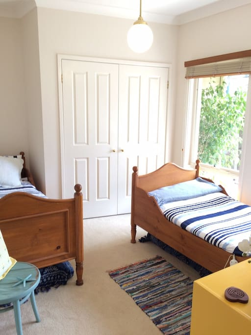A bright room with 2 single beds.