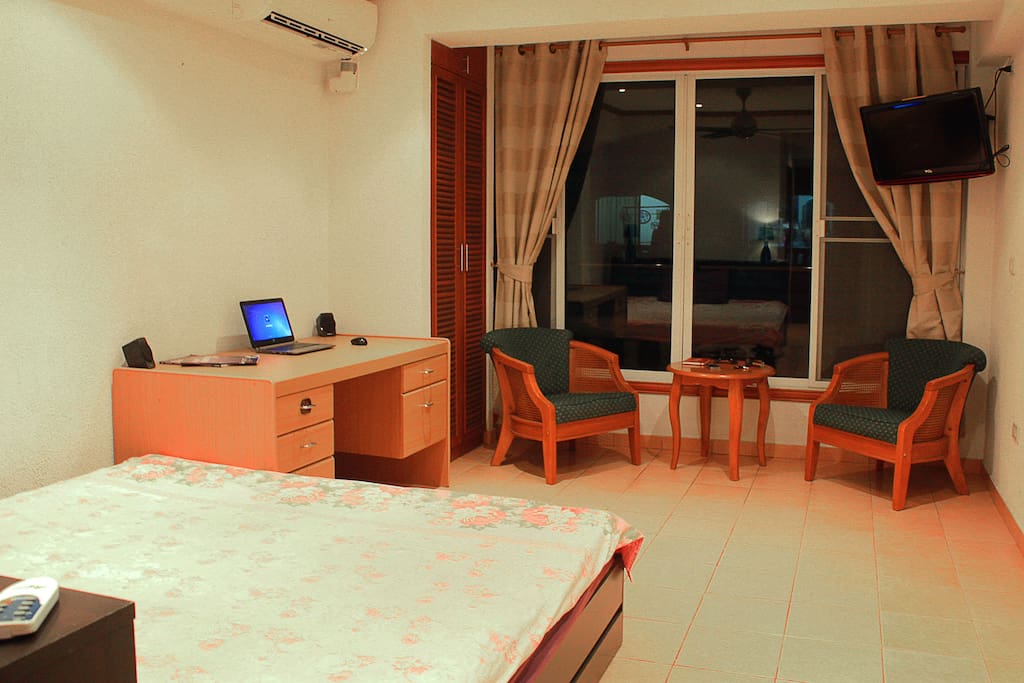 King-size bed, chairs and table, working desk, AC, TV