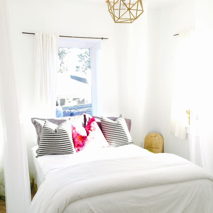 Bright and airy bedroom, large windows that allow a flood of light.