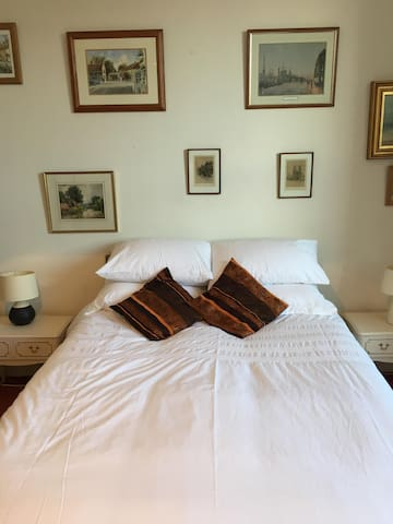 Spacious comfortable bedroom with king size bed.