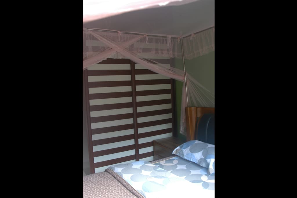 Bedroom - cozy with mosquito netting and spacious cupboard