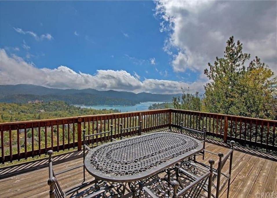 Outdoor dining with gorgeous views of lake.