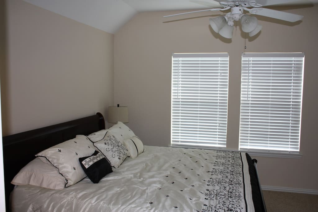 King size master bed in bedroom