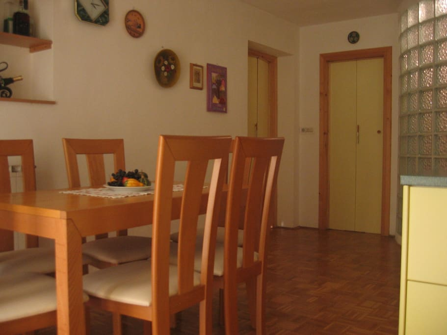 kitchen with dining area and a fridge