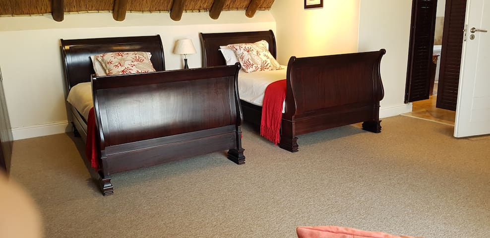 Room 2 - Sleeps 2 with en-suite and sliding doors leading out onto a patio.