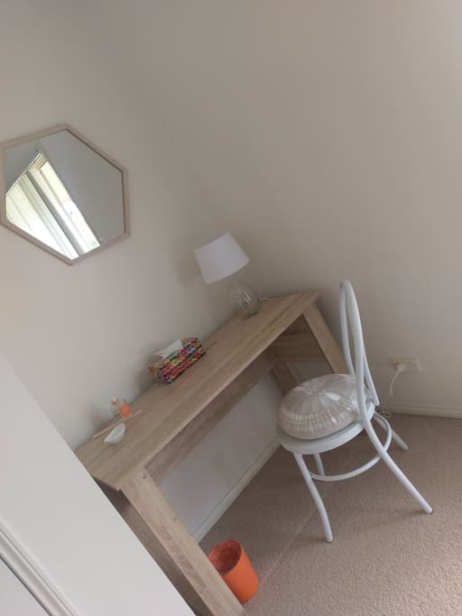 Small writing desk in room