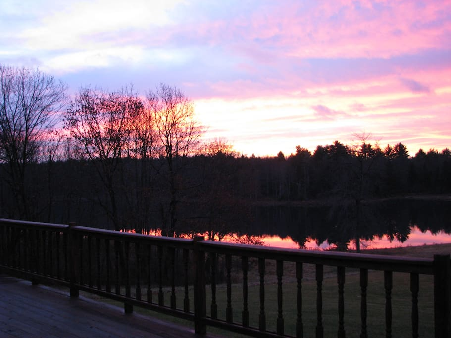 Sunrise over lake looking off the deck.