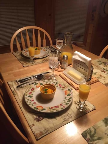 Typical breakfast setup. At owners dining room table.  Plates and utensils for omelettes, waffles, pancakes, sausages etc.  Fruit,  juice, butter, jam seasoning, napkins. Normal breakfast service from 7:30 till 9am.   Special breakfasts on request.
