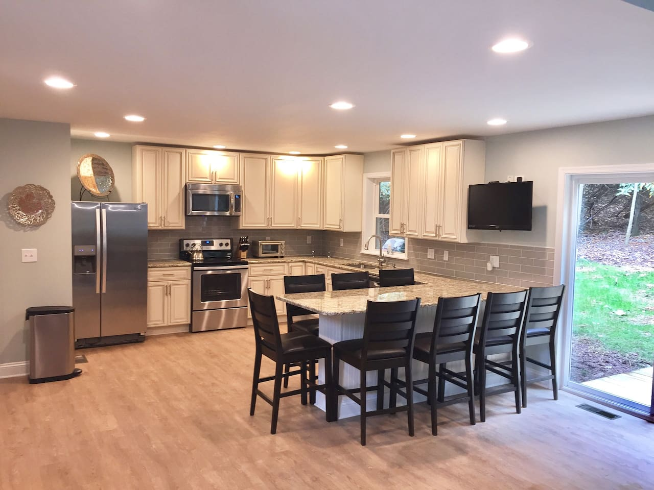 Large Chef's kitchen with Stainless appliances and granite countertops