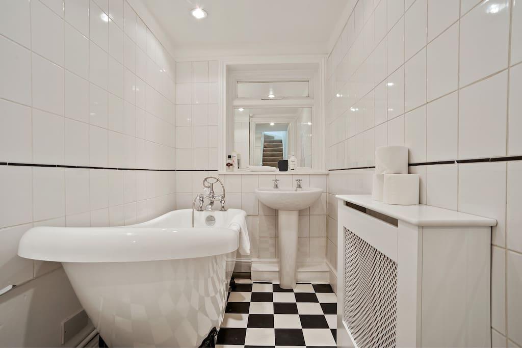 Enjoy a relaxing bath in family bathroom