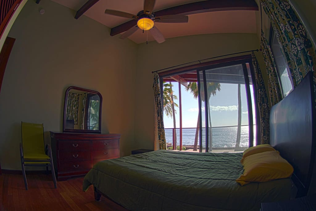 Ocean facing bedroom with walk out onto the veranda.
