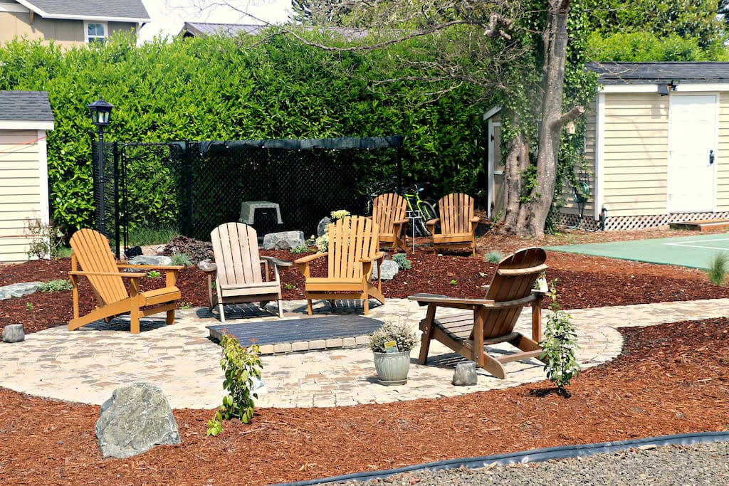Backyard fire pit and dog kennel