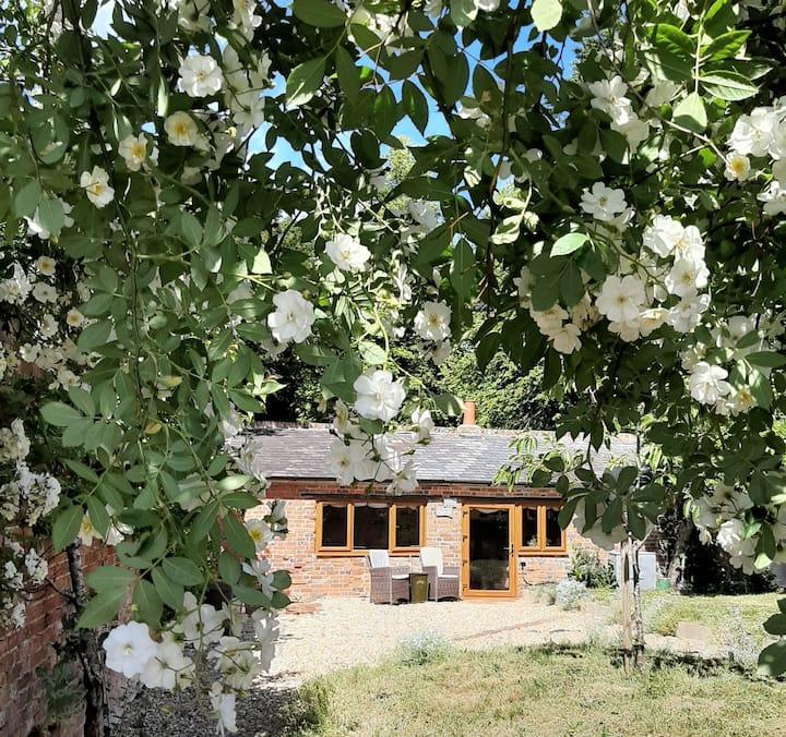 Pretty Potting Shed hidden away in a walled garden