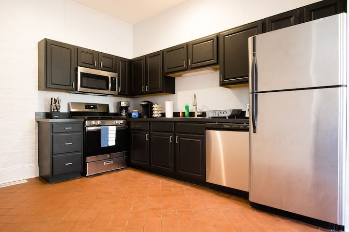 Brand new stainless steel appliances! The kitchen also features a Keurig coffee maker and K-Cups.
