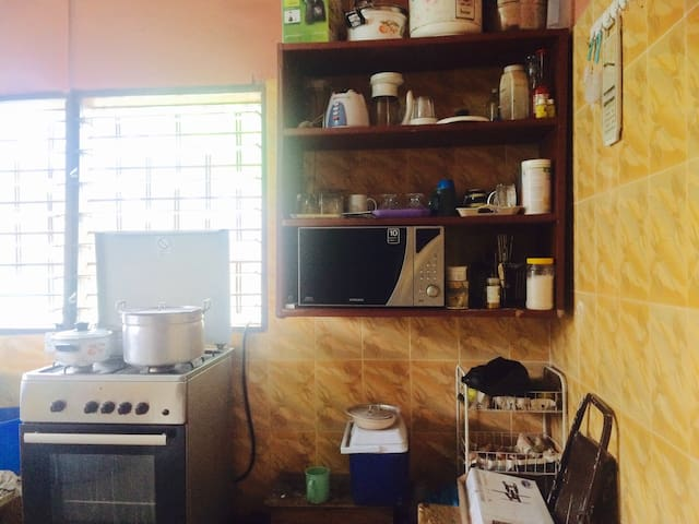 The kitchen, it also has a washing machine available for ten cedis per washing load. Food is available upon request for a small fee.
