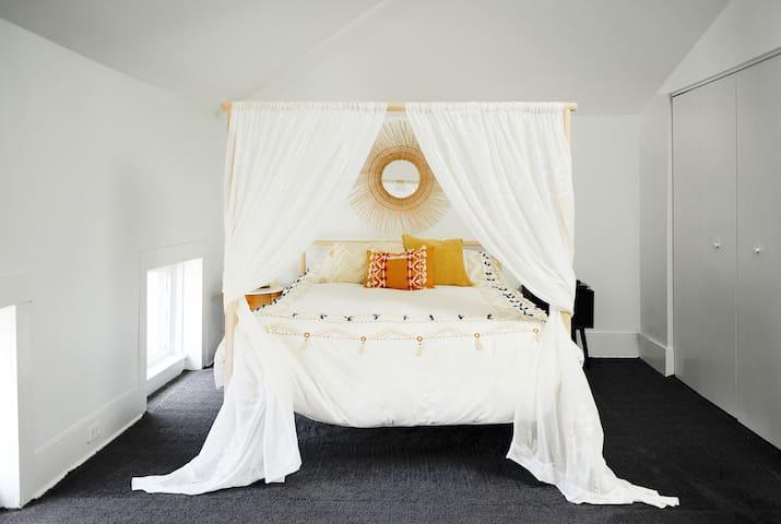 Queen memory foam mattress; Alexa and charging station at bedside