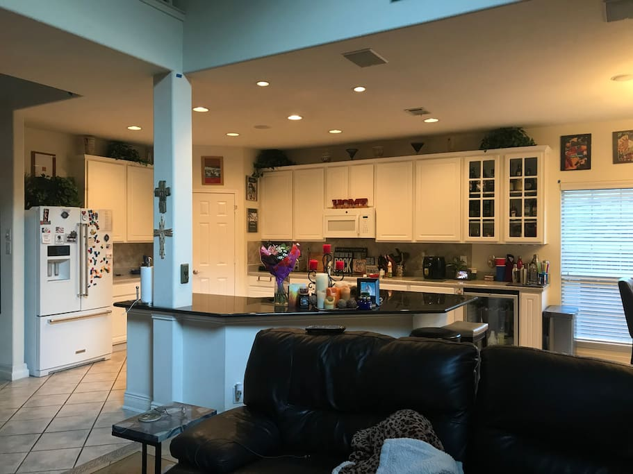 Large kitchen with all utensils, cookware, refrigerator, oven, microwave, dishwasher, coffee maker with complimentary coffee, and mini bar with complimentary liquor.