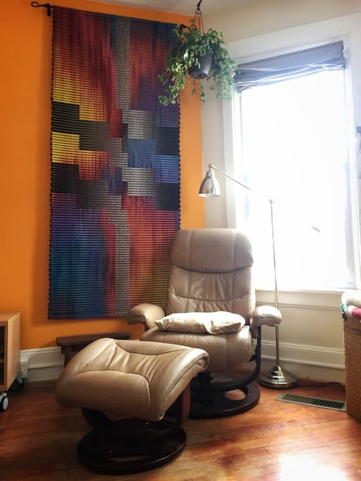 Cozy up with a book next to a handwoven Incan art piece