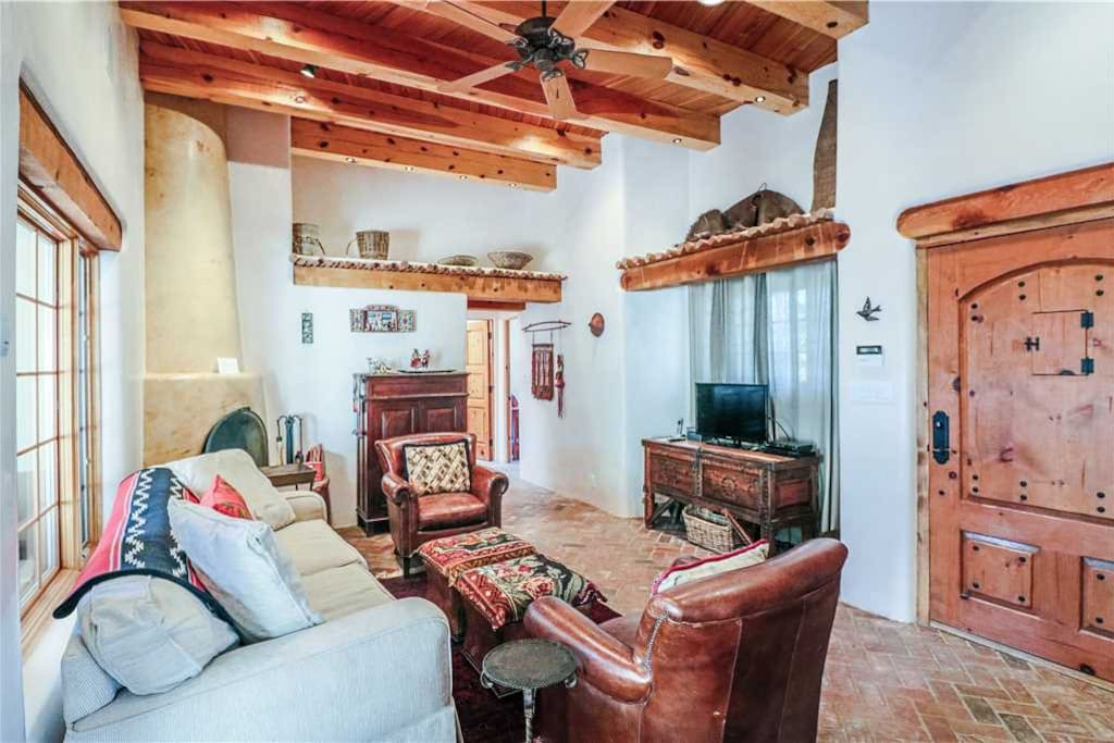 Family Room - Plush comfort and classic brick floors will feel wonderful on your weary feet after a long day of hiking, shopping, or skiing.