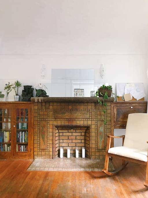 Studio with rocking chair & original mantle
