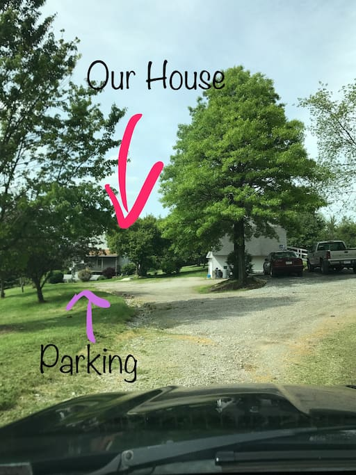 Our house from the driveway and guest parking is to the left