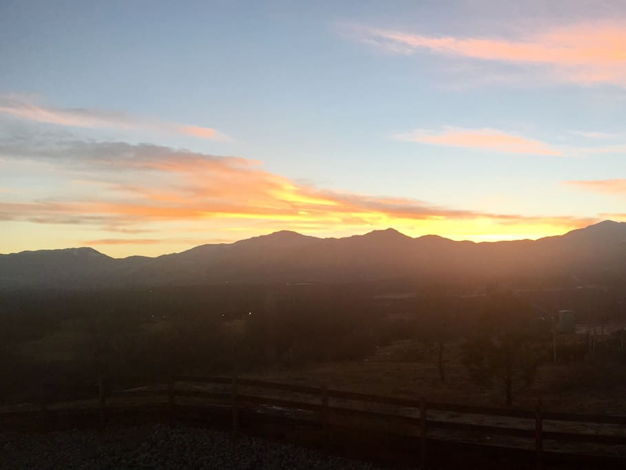 View at sunset from the backyard overlooking Falcons Stadium and the US Air Force Academy.