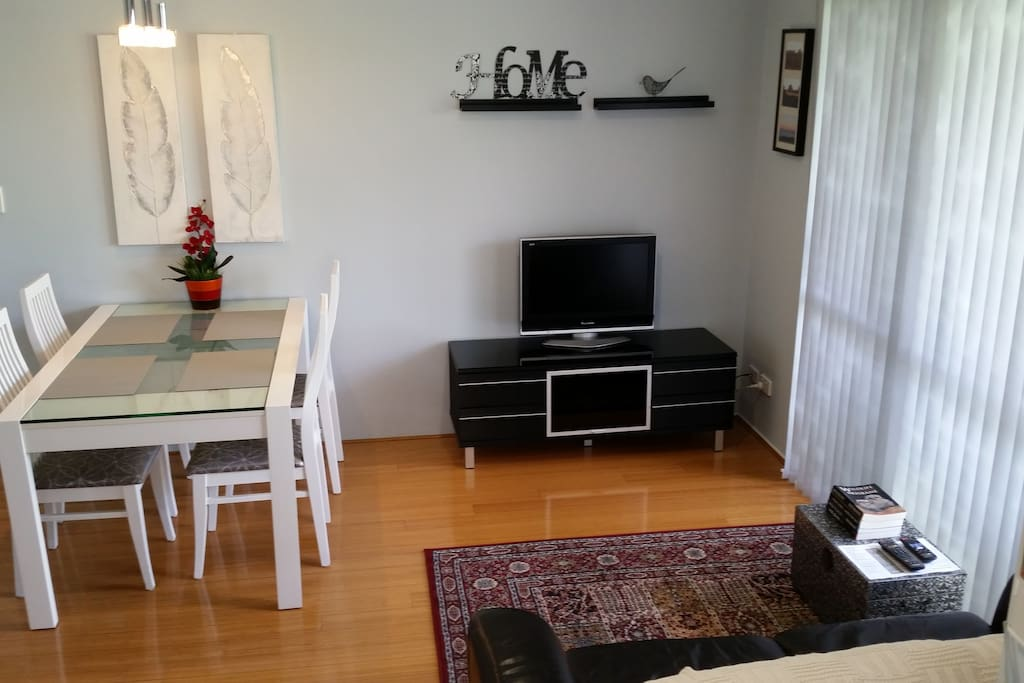 The unit is fresh, light and clean with bamboo flooring throughout.  A small balcony opens from the living area.