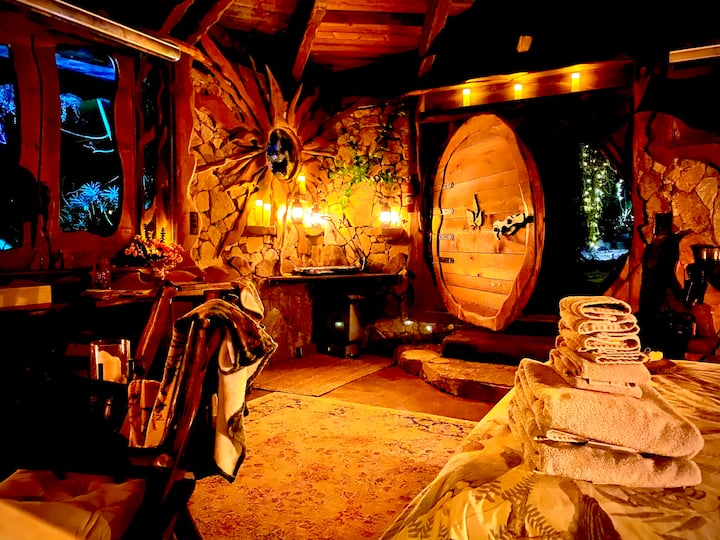 Battery operated candles and lanterns light the Hobbit hole near San Diego, California
