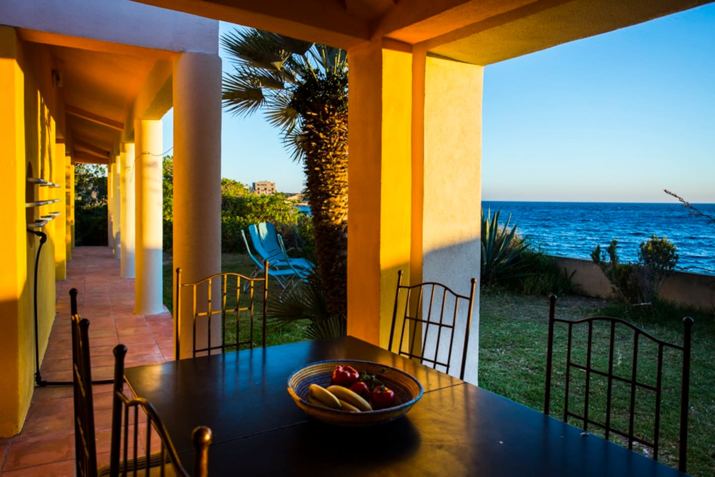 Second table in the garden with sea view with sun/rain protection.