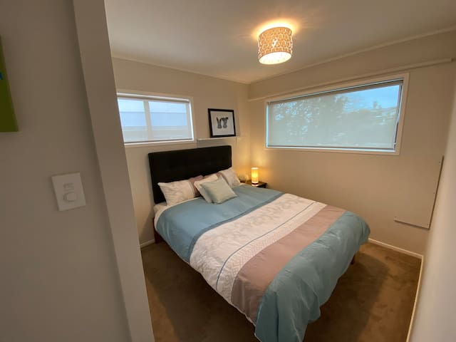 2nd bedroom.  Queen bed, bedside cabinet, blinds and thermal blackout curtains.  There is a wardrobe, light dimmer and bedside lamp.