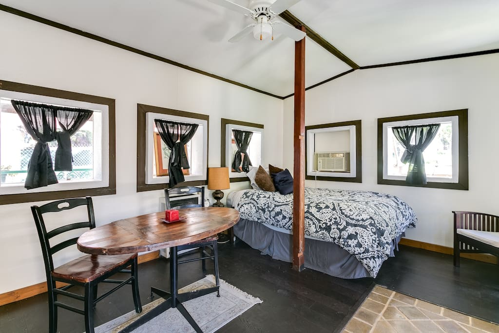 2 person table dining, new dark wood and tile floors.