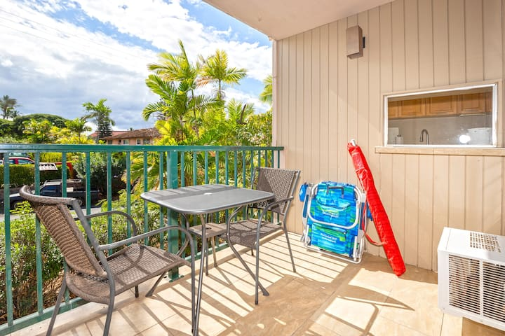 Lanai for outdoor dining, where we keep the two beach chairs and beach umbrella