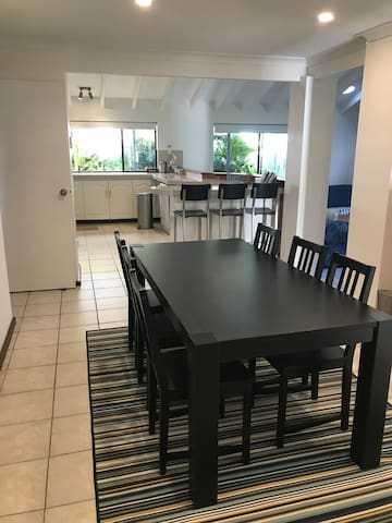 Dining area adjacent to large well-equipped kitchen