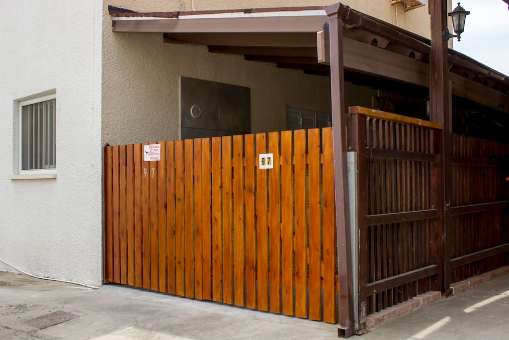 outside entrance of the house that leads to private covered parking
