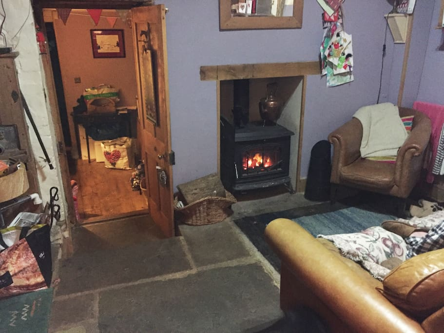 In the kitchen we also have a wood burner, sofa, armchair and wall mounted TV with Sky Q.