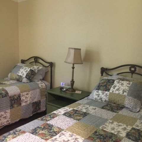 Twin beds with comfortable mattresses,  nightstand  and a charging station can be found in the first bedroom.