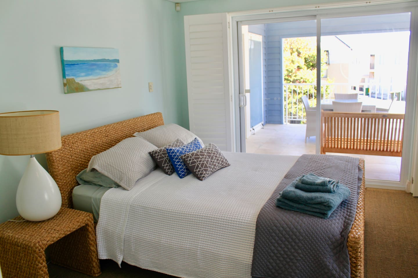 Main Bedroom leading to Balcony which overlooks beach