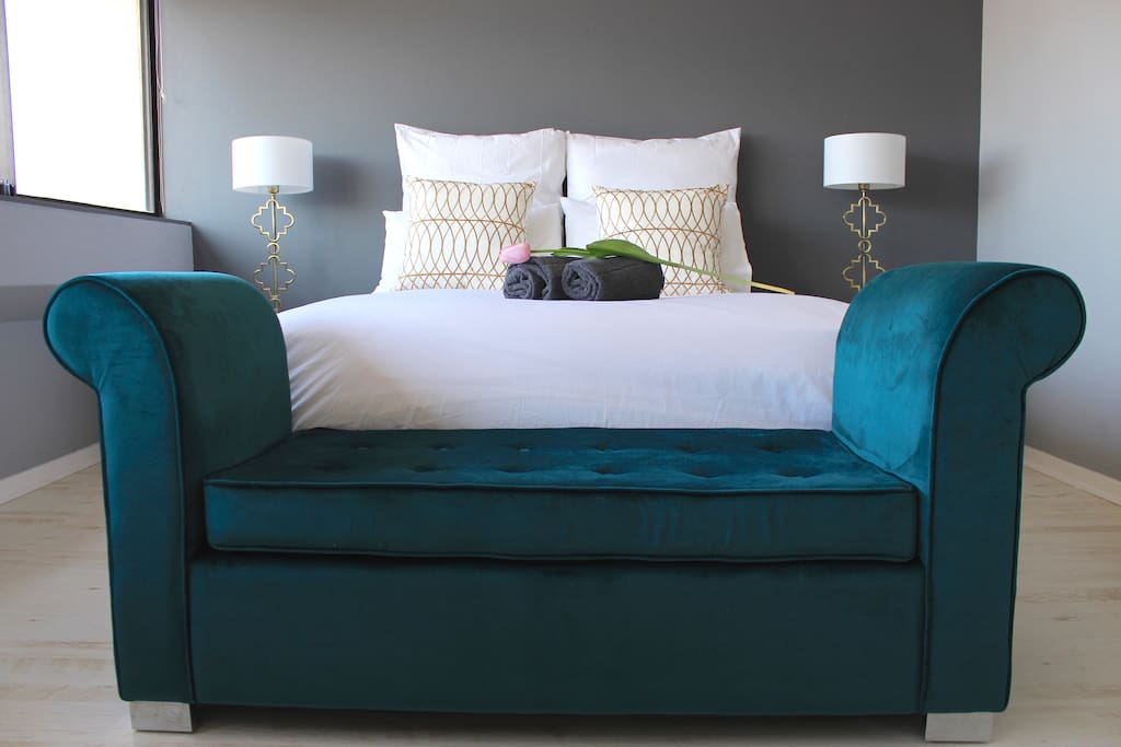 Comfy bed with velvet ottoman.