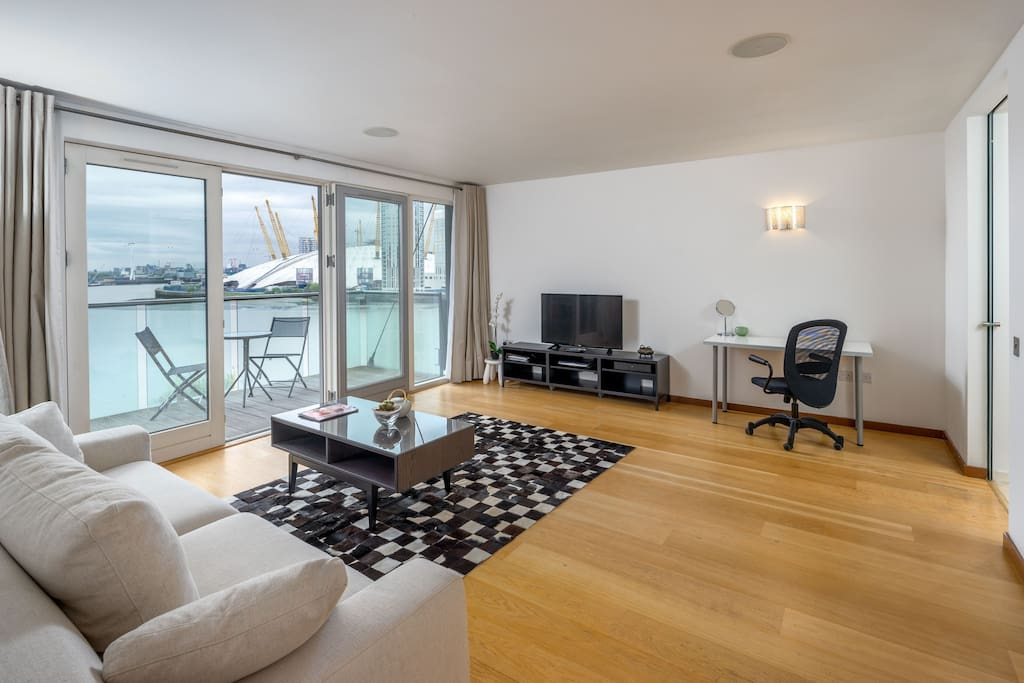 The living area is light and spacious with spectacular views over the River Thames.
