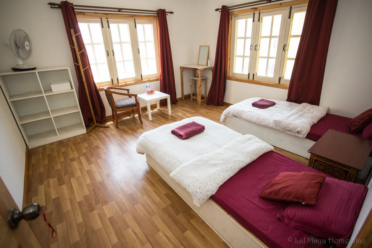 Ruby room of Amithaba with two single beds, bathroom shared with guests from Yellow room.