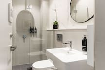 Crisp, clean and minimal - our communal shower rooms are fitted with luxury amenity for use during your stay.
