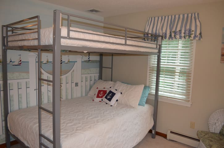 Second bedroom with full size bunk beds and twin trundle bed