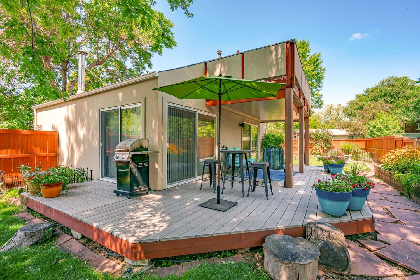 Spacious, well-manicured backyard/deck perfect for lounging after a day of work or adventures.