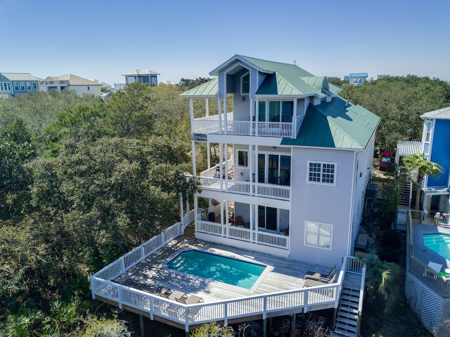 Beautiful, expanded pool deck overlooking lake -- and amazing balconies on each floor!