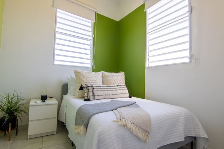 Ceiba Bedroom - Ambiance with AC and Smart Tv