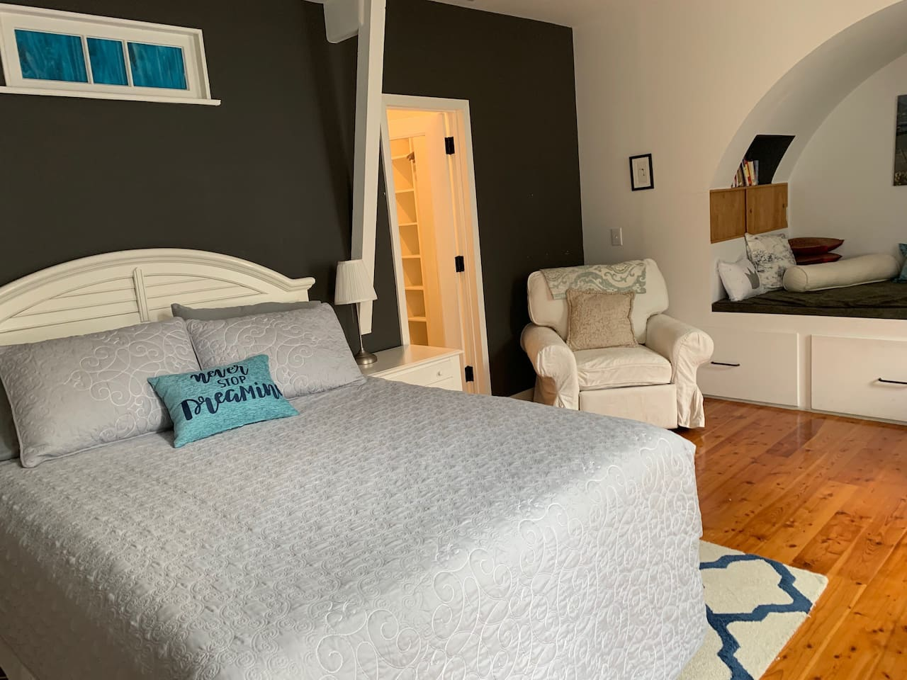 Comfortable queen bed, with bonus relaxation space. Large walk-in wardrobe, leading to en-suite bathroom. Many of our guests comment that the pictures don't accurately represent how spacious the room really is :)