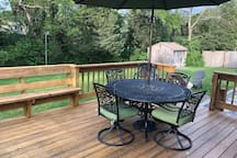 Deck with plenty of seating and grill